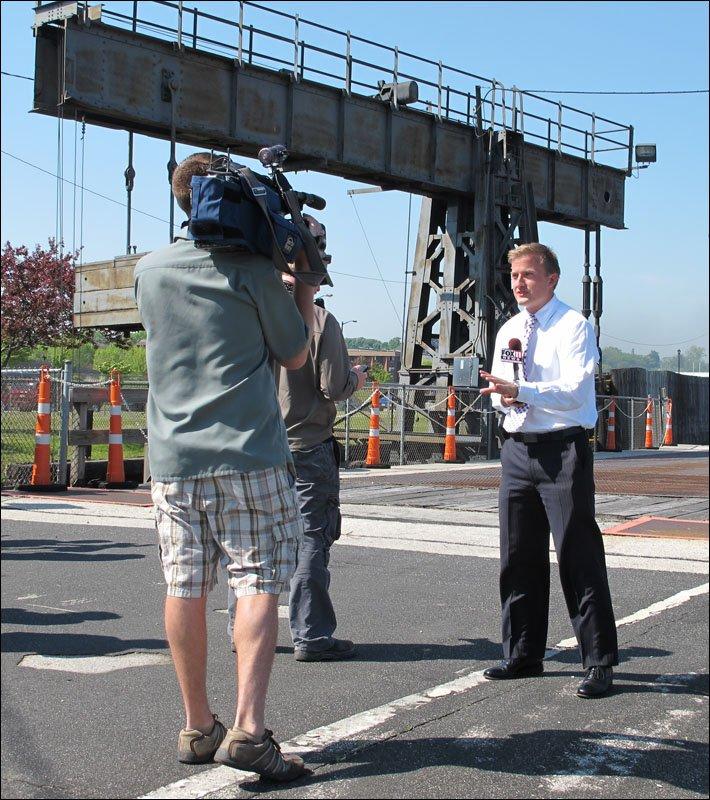 TV news reporter on camera