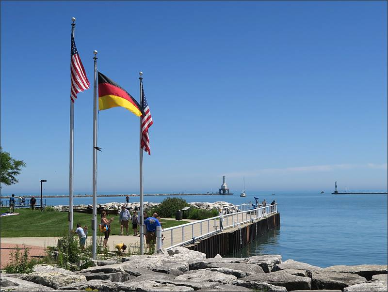 American and German flags fly over the harbor