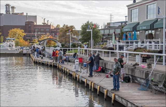 Salmon fishermen in Port Washington Inner Harbor